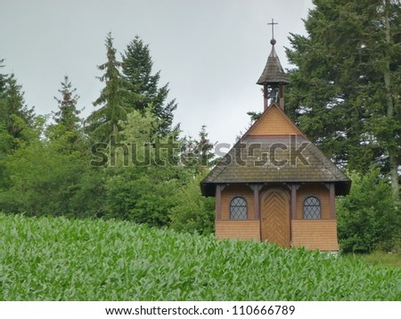 A wooden church with slates on the roof in the Black Forest in Germany