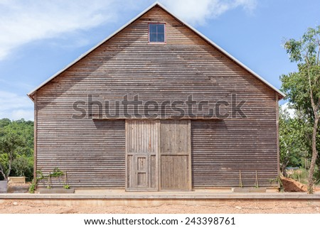 A wooden farm shed/ wooden barn and blue sky in Thailand