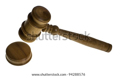 A wooden gavel is about to hit the strike plate isolated on white - stock photo