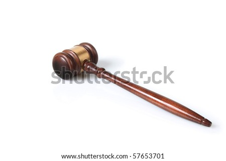 a wooden gavel on an isolated white background - stock photo