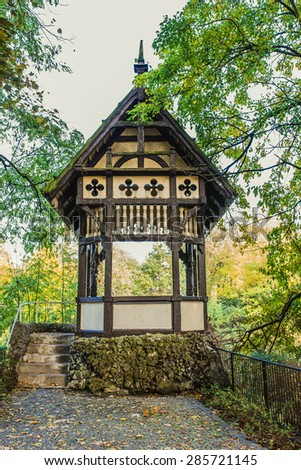 A wooden gazebo in summer city park. - stock photo