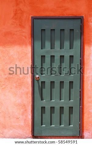 A wooden green door - stock photo
