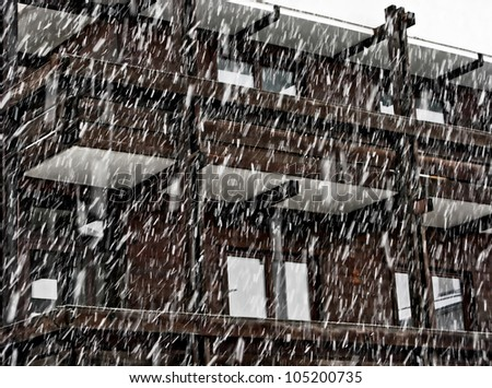 A wooden house in Mayrhofen during a heavy snowfall - Austria - stock photo