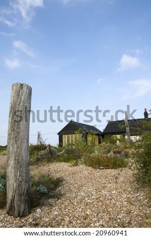 A wooden house with a shingle garden - stock photo