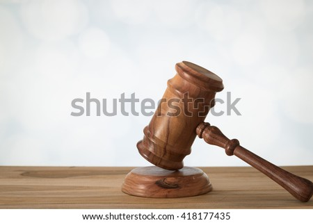 A wooden judge gavel and soundboard. Concept of Law, Legal, Auction, Lawsuit. - stock photo
