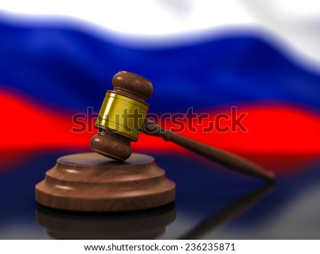 A Wooden Judge Gavel in Focus and Flag of Russia Waving in Background - stock photo