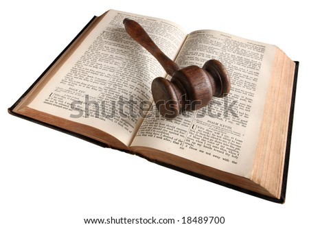 A wooden judge's gavel on an 1882 bible. - stock photo