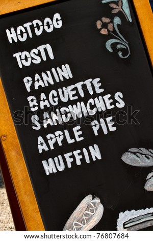 a wooden menu with different food