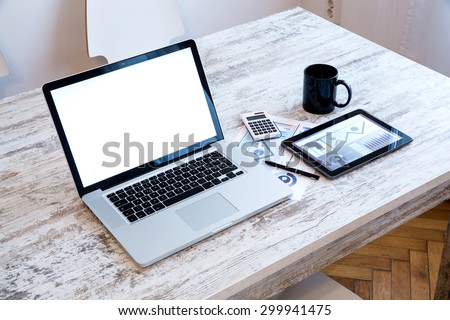 A wooden office Desktop with a Laptop and a Tablet PC.  - stock photo