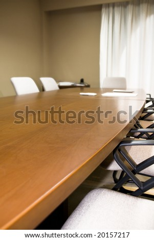 a wooden office table with chairs