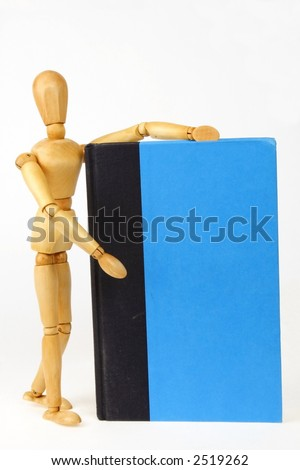 A wooden person introducing a book or bound report with a blank cover - stock photo