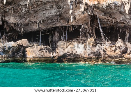 A wooden pier at the Viking cave, on the shore of Maya Island, part of Phi Phi islands in Andaman Sea, Thailand - stock photo