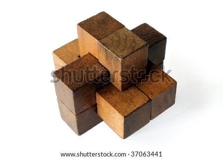 A wooden puzzle isolated on an white background - stock photo