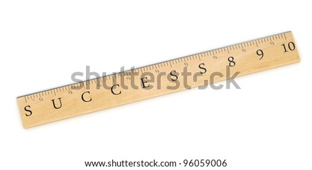 A wooden ruler concept used to measure success over white background