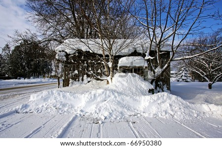 A wooden shed on a winter sunny day - stock photo