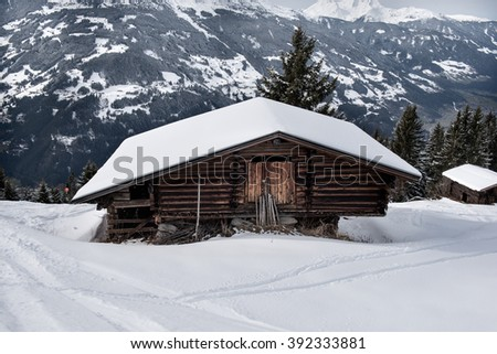 A wooden shed on the snowy slopes of the Karspitz Mountain viewed from above, Zillertal, Austria - stock photo