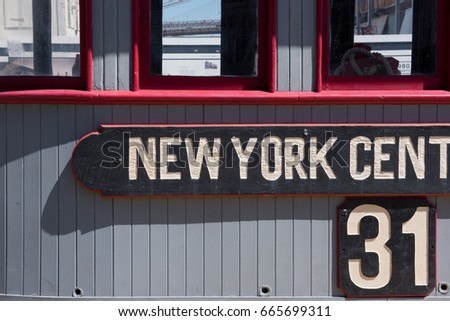 A wooden sign for an old New York City railroad terminal ticket office and information booth