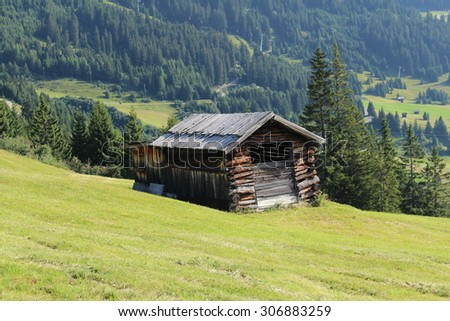 A wooden ski hut on Alp mountains with green meadow in Fiss, Tirol, Austria.  - stock photo