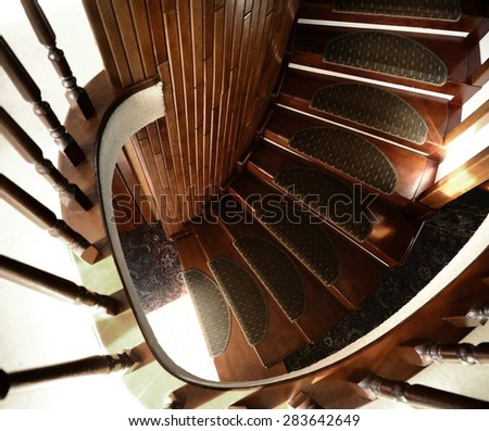 A wooden spiral staircase. - stock photo