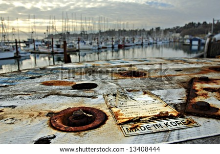 A wooden spool Made in Korea with harbor in background - stock photo