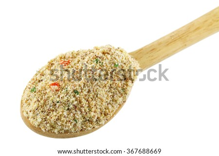 A wooden spoon full of stock booster powder, Beef flavored seasoning with dried vegetable for marinading and making soup - stock photo