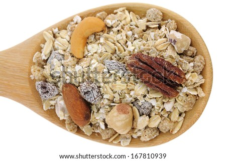 A wooden spoon of Fruit, Nut, Oat flakes and healthy Fiber Muesli isolated on white background - stock photo