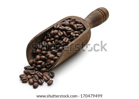 A wooden spoon with roasted coffee beans inside on white background. - stock photo