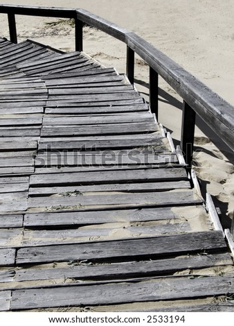 A wooden staircase leading down to beach