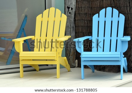 A wooden sun chairs in holiday home during summer vacation. - stock photo
