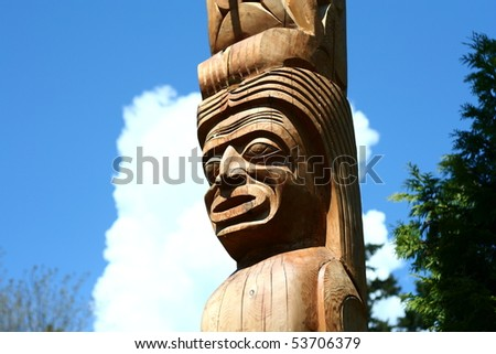 A wooden totem pole in Vancouver BC - stock photo