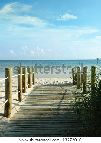 A wooden walkway to a white sand beach. Key West, Florida - stock photo