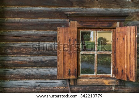 A wooden wall with window
