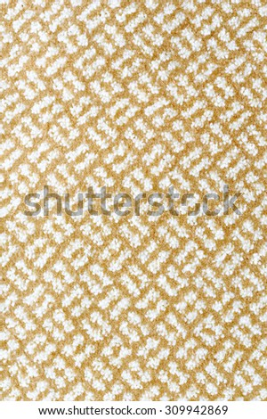 a woolen beige and white carpet with a relief pattern - stock photo