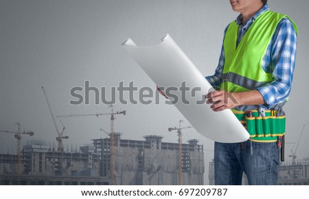 Worker man all tools supplies holding stock photo 100 legal a worker man with all of tools supplies holding construction plan blueprint ready for check and malvernweather Image collections