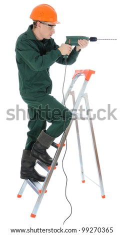 A worker with drill, isolated on white.