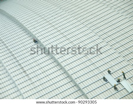 a workers working on the roof - stock photo