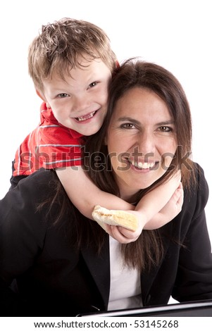 A working mom with her son around her neck. - stock photo