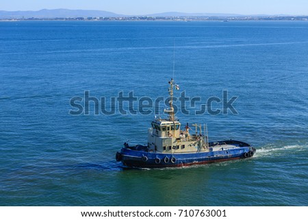 A working tugboat off the coast of Lisbon, Portugal