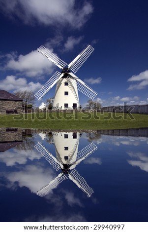 A working windmill with its reflection in waterAnglesey North Wales