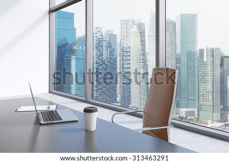 A workplace in a modern panoramic office with singapore view a grey table brown