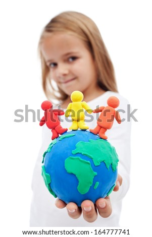 A world of harmony concept with little girl holding earth globe and people made of clay - stock photo