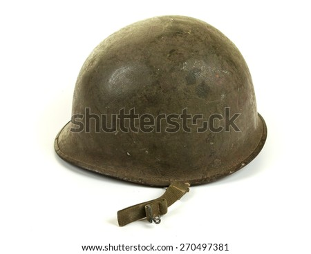 A World War Two period American U.S. Army soldier's steel combat helmet on white background - stock photo