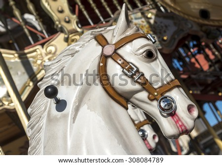 A worn and dirty white carousel horse head.