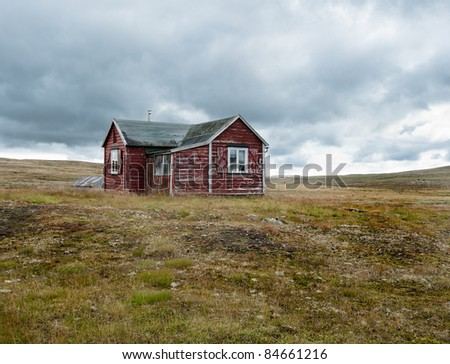A worn down cottage on the mountain - stock photo