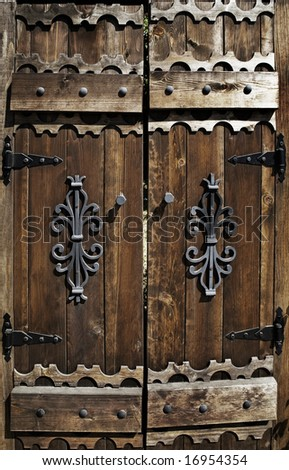 a worn out, old wooden door - stock photo