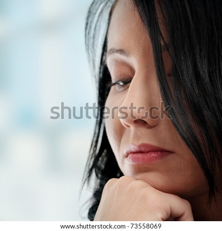 A worried and afraid young woman. - stock photo