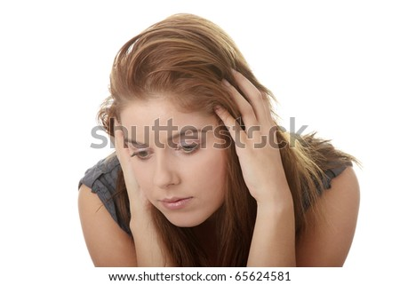 A worried and afraid young woman sitting on chair. Isolated