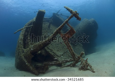 A wreck of a ship lying on the seabed - stock photo