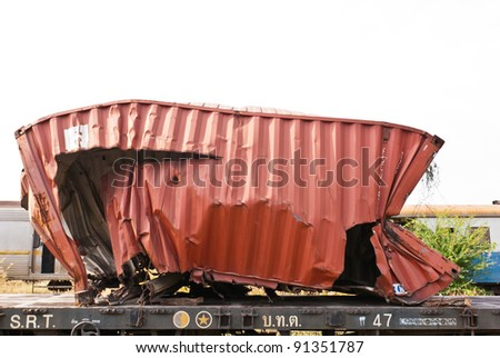 A wreckage of red steel container taken from train yard on a sunny day - stock photo