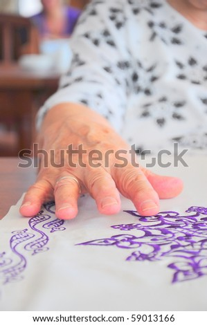 a wrinkled hand - stock photo